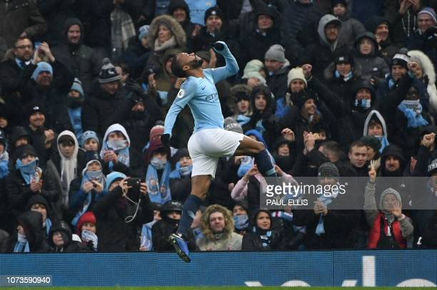 Manchester City's English midfielder Raheem Sterling celebrates scoring his team's third goal during the English Premier League football match...