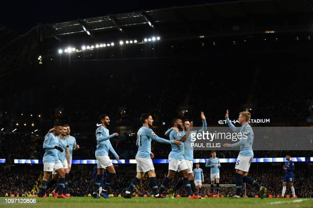 Manchester City's English midfielder Raheem Sterling celebrates scoring his team's sixth goal during the English Premier League football match...