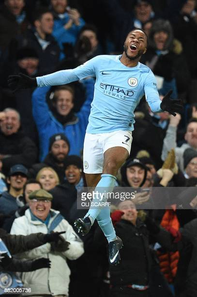 Manchester City's English midfielder Raheem Sterling celebrates scoring his team's second goal during the English Premier League football match...