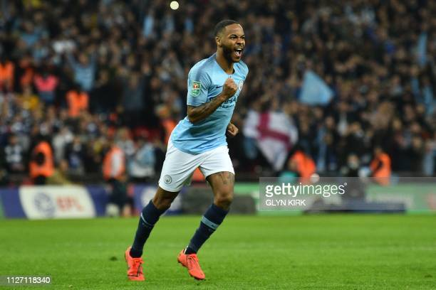 Manchester City's English midfielder Raheem Sterling celebrates scoring the winning penalty in the penalty shootout at the end of the English League...