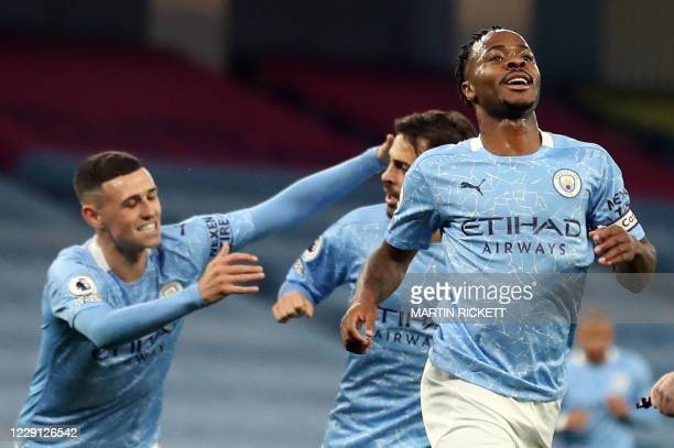 Manchester City's English midfielder Raheem Sterling celebrates scoring the opening goal during the English Premier League football match between...