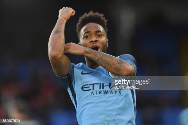 Manchester City's English midfielder Raheem Sterling celebrates scoring the opening goal during the English FA Cup fourth round football match...