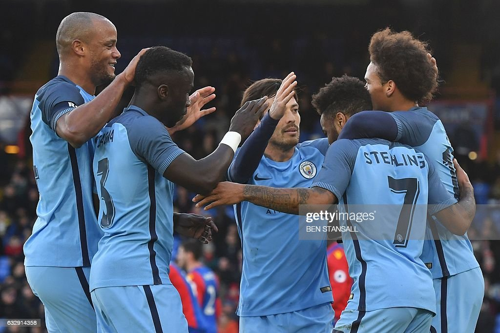 Manchester City's English midfielder Raheem Sterling (2R) celebrates scoring the opening goal with team-mates during the English FA Cup fourth round football match between Crystal Palace and Manchester City at Selhurst Park in south London on January 28, 2017. / AFP / Ben STANSALL / RESTRICTED TO EDITORIAL USE. No use with unauthorized audio, video, data, fixture lists, club/league logos or 'live' services. Online in-match use limited to 75 images, no video emulation. No use in betting, games or single club/league/player publications. /