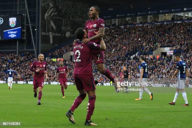 Manchester City's English midfielder Raheem Sterling celebrates scoring the team's third goal with Manchester City's English defender Kyle Walker...