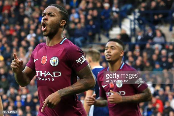 Manchester City's English midfielder Raheem Sterling celebrates scoring the team's third goal during the English Premier League football match...