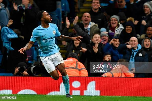 Manchester City's English midfielder Raheem Sterling celebrates scoring the opening goal during the UEFA Champions League Group F football match...