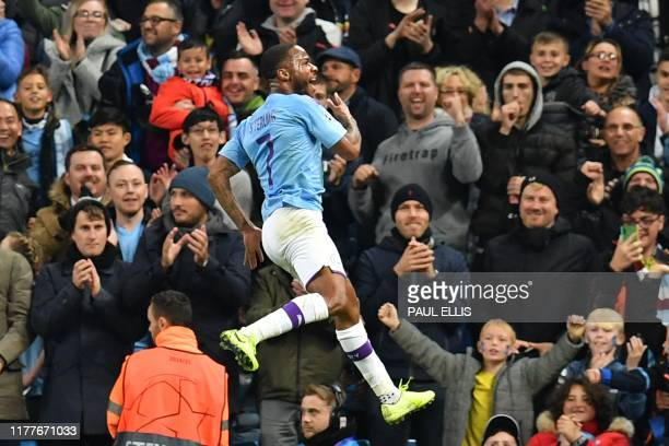 Manchester City's English midfielder Raheem Sterling celebrates scoring their fifth goal to complete his hattrick during the UEFA Champions League...