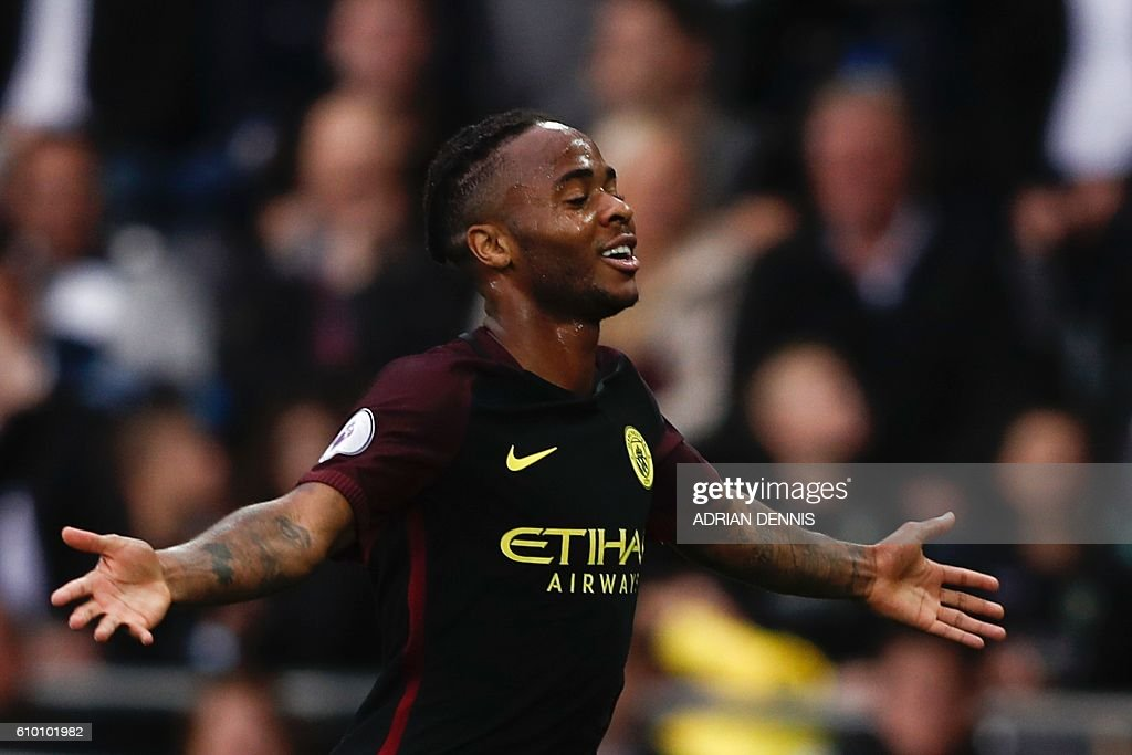 Manchester City's English midfielder Raheem Sterling celebrates scoring their third goal during the English Premier League football match between Swansea City and Manchester City at The Liberty Stadium in Swansea, south Wales on September 24, 2016. / AFP / Adrian DENNIS / RESTRICTED TO EDITORIAL USE. No use with unauthorized audio, video, data, fixture lists, club/league logos or 'live' services. Online in-match use limited to 75 images, no video emulation. No use in betting, games or single club/league/player publications. /