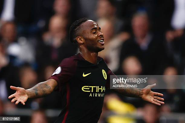 Manchester City's English midfielder Raheem Sterling celebrates scoring their third goal during the English Premier League football match between...