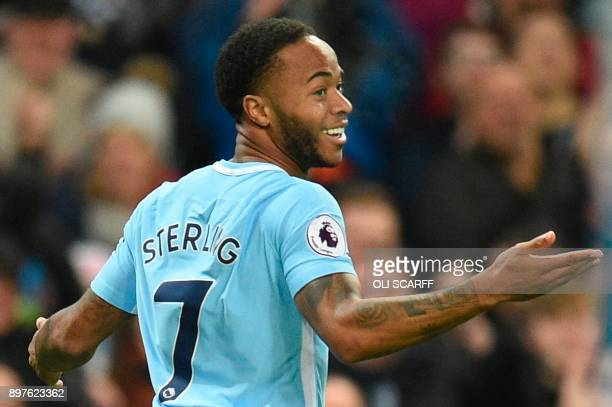 Manchester City's English midfielder Raheem Sterling celebrates scoring their second goal during the English Premier League football match between...