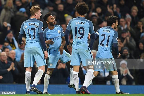 Manchester City's English midfielder Raheem Sterling celebrates with teammates after scoring their second goal during the English Premier League...