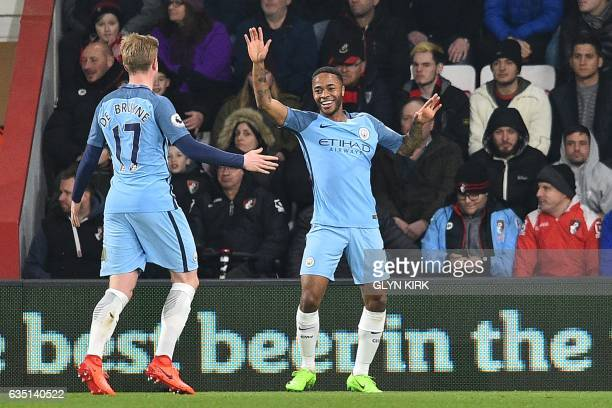 Manchester City's English midfielder Raheem Sterling celebrates with Manchester City's Belgian midfielder Kevin De Bruyne after scoring the opening...