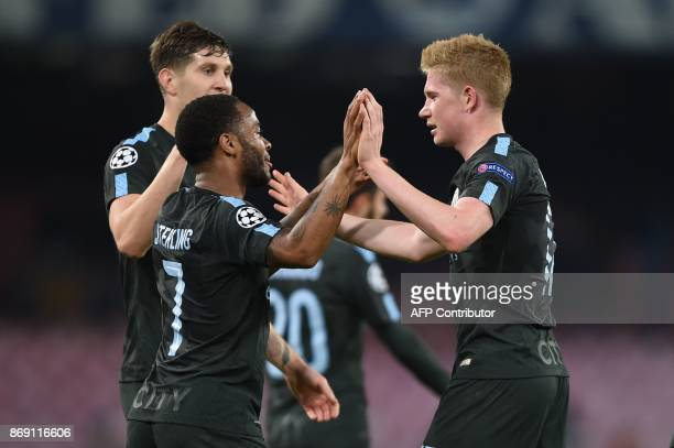 Manchester City's English midfielder Raheem Sterling celebrates with Manchester City's Belgian midfielder Kevin De Bruyne after scoring during the...