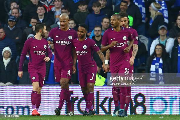 Manchester City's English midfielder Raheem Sterling celebrates with teammates after scoring their second goal during the English FA Cup fourth round...