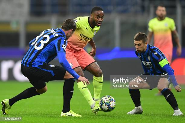 Manchester City's English midfielder Raheem Sterling challenges Atalanta's Dutch defender Hans Hateboer and Atalanta's Argentinian forward Papu Gomez...