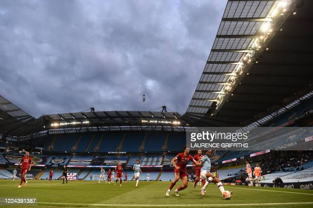 Manchester City's English midfielder Raheem Sterling controls the ball under cloudy skies during the English Premier League football match between...