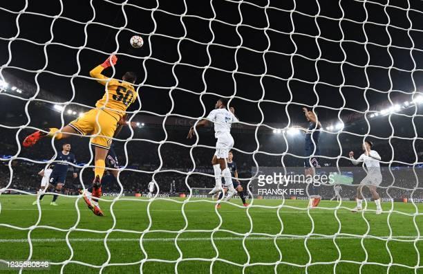 Manchester City's English midfielder Raheem Sterling heads the ball past Paris Saint-Germain's Italian goalkeeper Gianluigi Donnarumma but hits the...