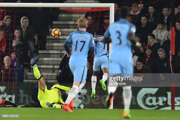 Manchester City's English midfielder Raheem Sterling heads the opening goal past Bournemouth's Polish goalkeeper Artur Boruc during the English...