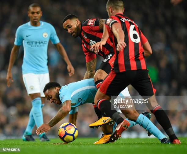 Manchester City's English midfielder Raheem Sterling is challenged by Bournemouth's South Africanborn English midfielder Andrew Surman during the...