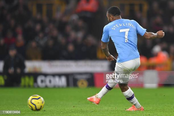 Manchester City's English midfielder Raheem Sterling kicks the first penalty saved by Wolverhampton Wanderers' Portuguese goalkeeper Rui Patricio...