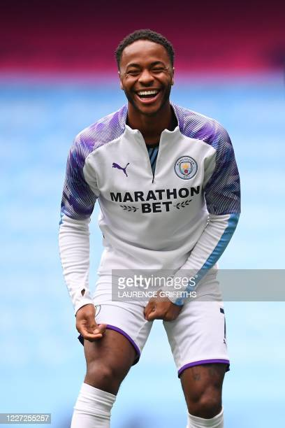 Manchester City's English midfielder Raheem Sterling laughs during a warm up session ahead of the English Premier League football match between...