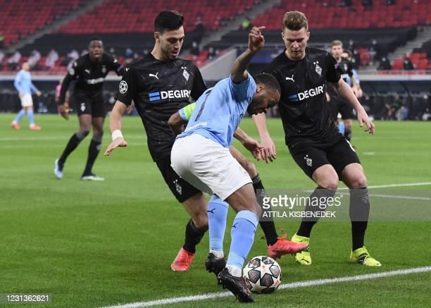 Manchester City's English midfielder Raheem Sterling , Moenchengladbach's Algerian defender Ramy Bensebaini and Moenchengladbach's Swiss defender...