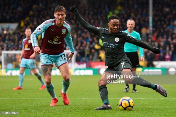 Manchester City's English midfielder Raheem Sterling plays the ball under pressure from Burnley's Irish midfielder Jeff Hendrick during the English...