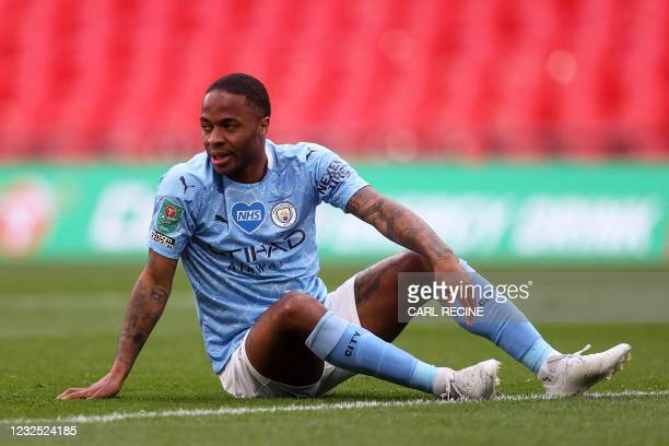 Manchester City's English midfielder Raheem Sterling reacts after failing to score during the English League Cup final football match between...