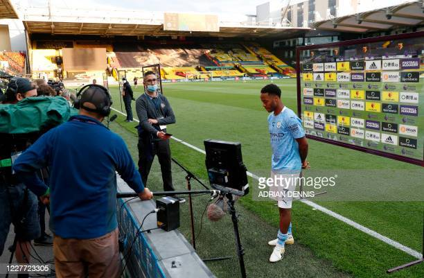Manchester City's English midfielder Raheem Sterling reacts during the post-match interview after the English Premier League football match between...