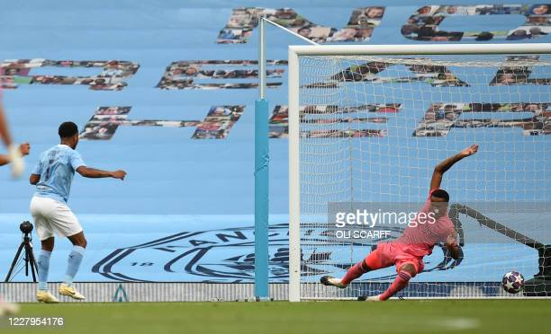Manchester City's English midfielder Raheem Sterling scores the opening goal during the UEFA Champions League round of 16 second leg football match...