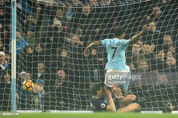 Manchester City's English midfielder Raheem Sterling scores their third goal past Tottenham Hotspur's Belgian defender Jan Vertonghen during the...