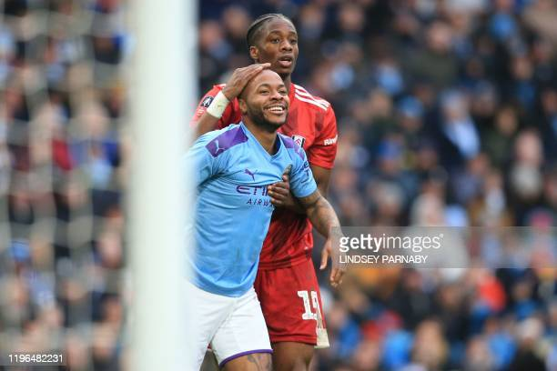 Manchester City's English midfielder Raheem Sterling shares a joke with Fulham's Swiss-born Dutch defender Terence Kongolo during the English FA Cup...