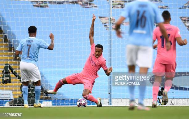 Manchester City's English midfielder Raheem Sterling shoots and scores a goal during the UEFA Champions League round of 16 second leg football match...