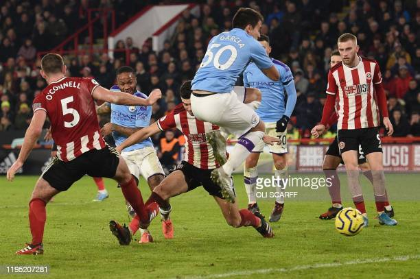 Manchester City's English midfielder Raheem Sterling shoots but fails to score during the English Premier League football match between Sheffield...