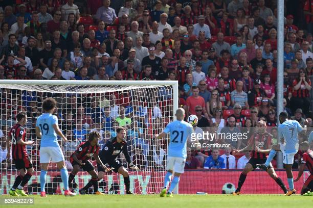 Manchester City's English midfielder Raheem Sterling shoots to score their late winning goal during the English Premier League football match between...