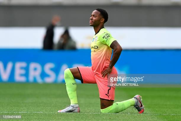 Manchester City's English midfielder Raheem Sterling takes a knee to show solidarity with the Black Lives Matter movement against racism before kick...