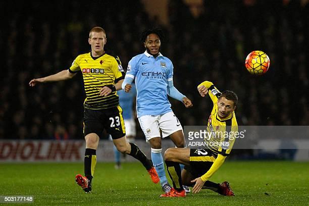 Manchester City's English midfielder Raheem Sterling vies with Watford's English midfielder Ben Watson and Watford's Yugoslavianborn Swiss midfielder...
