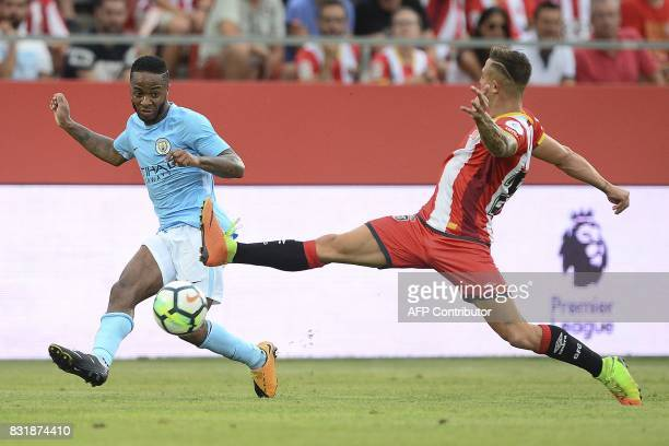 Manchester City's English midfielder Raheem Sterling vies with Girona's defender Pablo Maffeo during the Costa Brava trophy friendly football match...