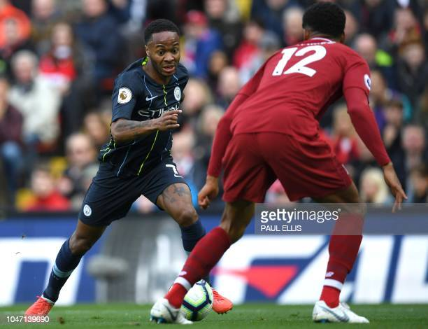 Manchester City's English midfielder Raheem Sterling vies with Liverpool's English defender Joe Gomez during the English Premier League football...