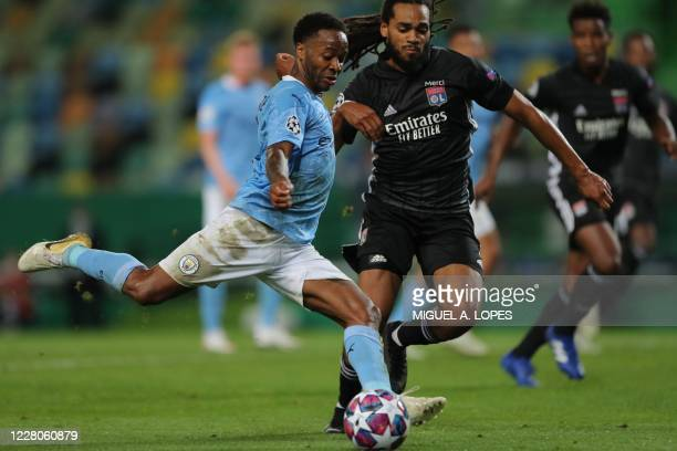Manchester City's English midfielder Raheem Sterling vies with Lyon's Belgian defender Jason Denayer during the UEFA Champions League quarter-final...