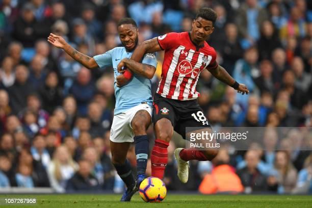 TOPSHOT Manchester City's English midfielder Raheem Sterling vies with Southampton's Gabonese midfielder Mario Lemina during the English Premier...