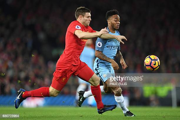 Manchester City's English midfielder Raheem Sterling vies with Liverpool's English midfielder James Milner during the English Premier League football...