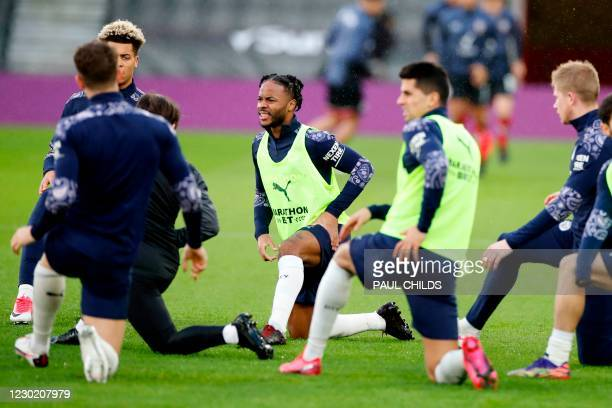 Manchester City's English midfielder Raheem Sterling warms up with teammates ahead of the English Premier League football match between Southampton...