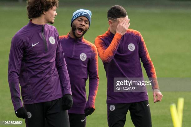Manchester City's English midfielder Raheem Sterling yawns during a team training session at City Football Academy in Manchester, north west England...