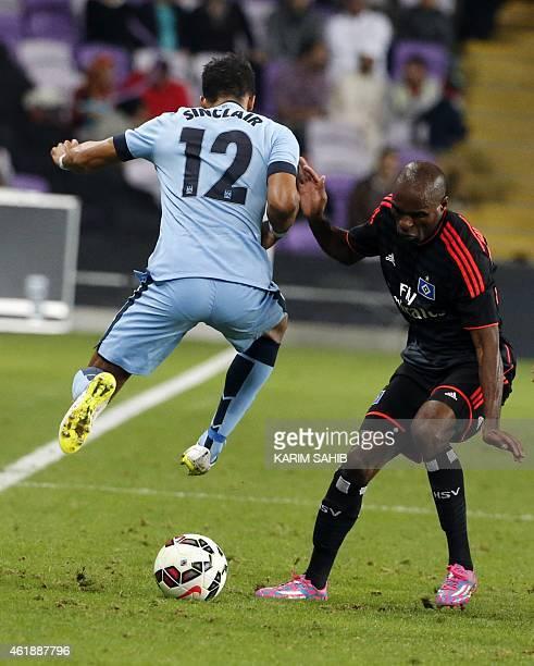 Manchester City's English midfielder Scott Sinclair vies for the ball with Hamburg SV's German midfielder Ashton Gotz during their friendly football...