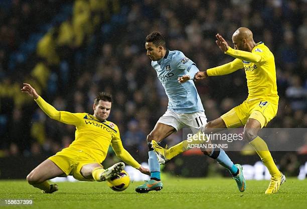 Manchester City's English midfielder Scott Sinclair vies with Reading's English midfielder Danny Guthrie and Malian midfielder Jimmy Kebe during the...