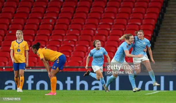 Manchester City's English striker Georgia Stanway celebrates scoring in extra time with Manchester City's American midfielder Sam Mewis during the...