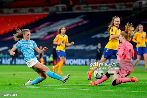 Manchester City's English striker Georgia Stanway shoots to score a goal in extra-time past Everton's English goalkeeper Sandy Maciver during the...