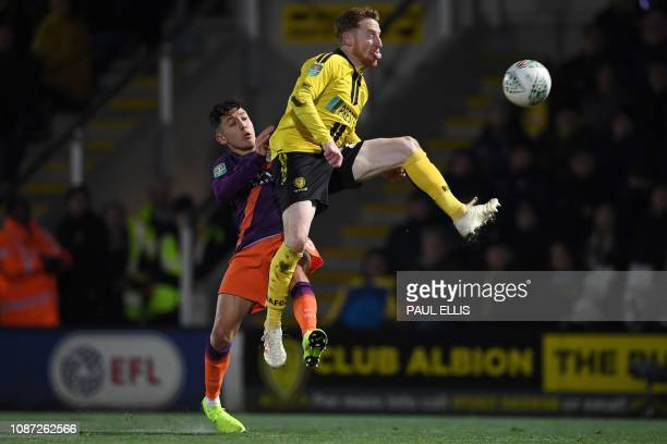 TOPSHOT Manchester City's English striker Ian Carlo Proveda vies with Burton Albion's Irish midfielder Stephen Quinn during the English League Cup...