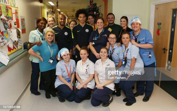 Manchester City's Fabian Delph and Leroy Sane visit the Royal Manchester Children's Hospital on December 13, 2018 in Manchester, England.